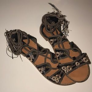 Bohemian laced sandals.
